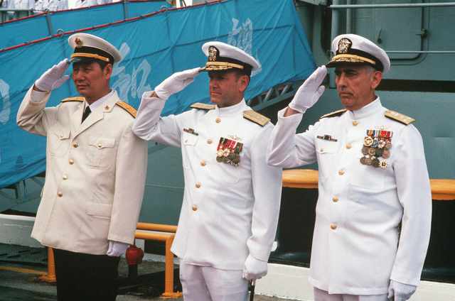 Vice Admiral (VADM) Ma Xin Chun, Commander of the Chinese North Sea Fleet (left), Admiral (ADM) David Jeremiah, Commander-in-CHIEF, US Pacific Fleet, (center), and VADM James Dorsey Jr., Commander, US Third Fleet, salute at ceremonies of the visiting Chinese training ship ZHENG HE