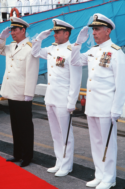 Vice Admiral (VADM) Ma Xin Chun, Commander of the Chinese North Sea Fleet (left), Admiral (ADM) David Jeremiah, Commander-in-CHIEF, US Pacific Fleet, (center), and VADM James Dorsey Jr., Commander, US Third Fleet, salute at ceremonies for the visiting Chinese training ship ZHENG HE