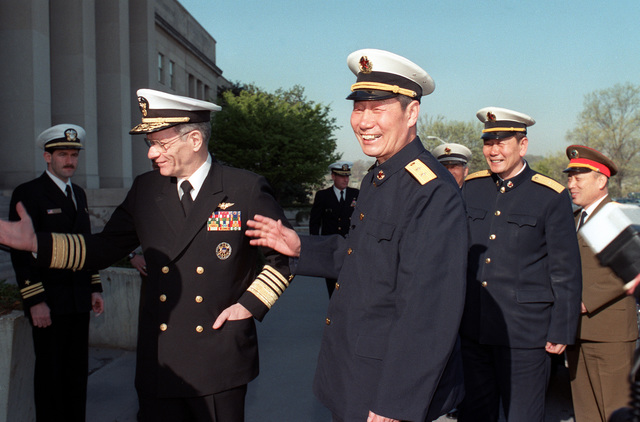 ADM Leon A. Edney, vice chief of naval operations, hosts VADM Ma Xin Chun, commander of the North Sea Fleet of the People's Republic of China, center right, and aides on their tour of the Pentagon
