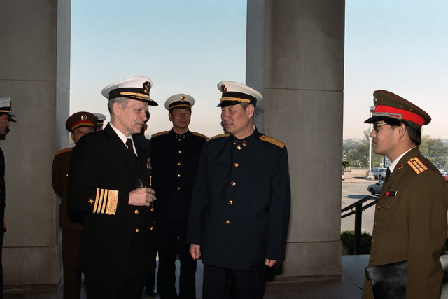 Admiral (ADM) Leon A. Edney, vice chief of naval operations, hosts Vice Admiral (VADM) Ma Xin Chun, commander of the North Sea Fleet of the People's Republic of China, center right, and aides on their tour of the Pentagon