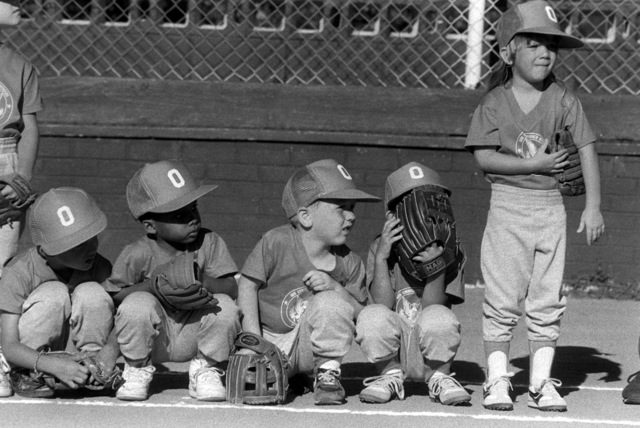 Players wait for the start of a T-ball game at the naval air station. Volunteers from the station host youth activities as part of their community involvement program
