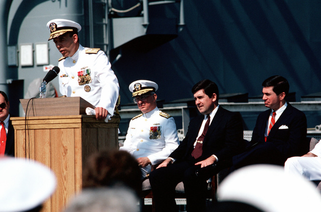 Rear Admiral Stephen S. Clarey, deputy commander/comptroller, Naval Sea Systems Command, speaks at the commissioning ceremony for the dock landing ship USS GUNSTON HALL (LSD 44).  Seated behind him are, from left to right, Vice Admiral (VADM) John W. Nyquist, assistant chief of naval operations, Surface Warfare; Secretary of the Navy William L. Ball III; and Senator Charles S. Robb of Virginia