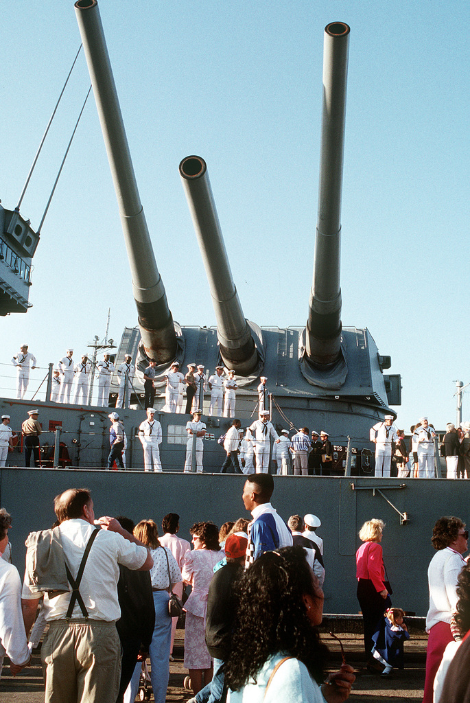 The 16-inch guns aboard the battleship USS IOWA (BB-61) loom