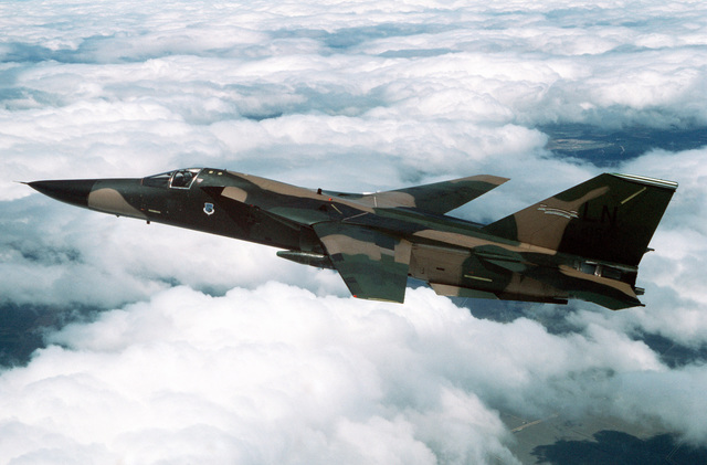An air-to-air left side view of a 495th Tactical Fighter Squadron F-111F aircraft flying a mission out of Moron Air Base, Spain, during Open Gate '89. Open Gate is a Joint Chiefs of STAFF/NATO exercise designed to simulate air and sea power tactics required to keep the Straits of Gibraltar open during a crisis