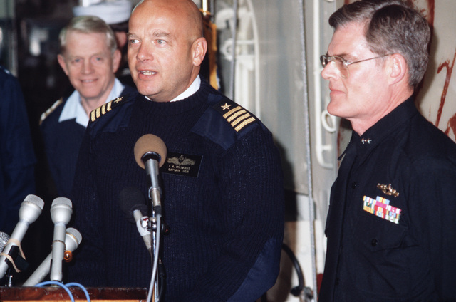 Captain (CAPT) Ted S. Willandt, commanding officer of the Dock Landing Ship USS JUNEAU (LPD 10), talks about the Navy's role in the EXXON VALDEZ oil spill cleanup during a briefing aboard the JUNEAU.  At left is Coast Guard Vice Admiral (VADM) Clyde E. Robbins, Pacific area commander of Amphibious Group Three, is at right