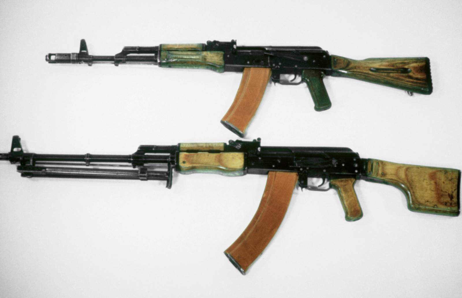 A left side view of a 5 45mm Soviet AK-74 assault rifle, top, and a