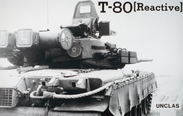 A right rear view of a Soviet T80 main battle tank.  The T80 is the Soviet Union's latest main battle tank and is outfitted with reactive armor designed to dissipate the force of exploding anti-tank weapons