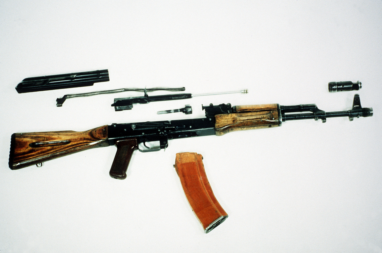 A right side view of a field-stripped Soviet AK-74 assault rifle