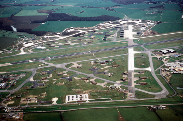 An aerial view of a portion of the base, showing the main runway and hangar area. The 10th Tactical Fighter Wing, U.S. Air Force Europe (USAFE), and TR-1 aircraft of the 17th Reconnaissance Wing, Strategic Air Command (SAC), are based at Alconbury