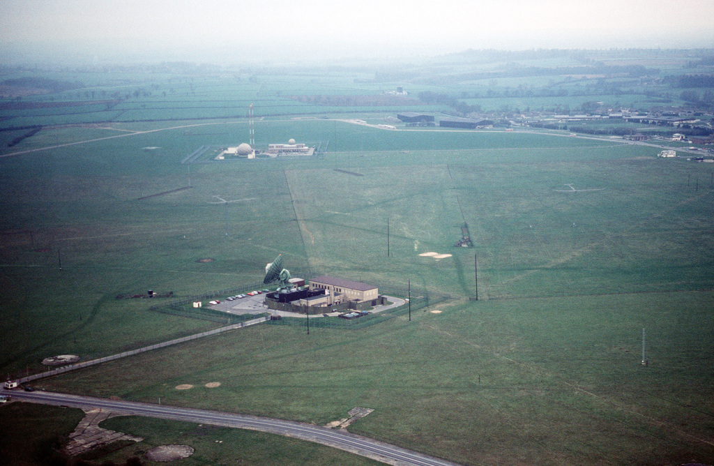 An aerial view of two communications site on the base. The 2130th Information Systems Squadron, Air Force Communications Command (AFCC), operates a node of the Defense Communications System at Croughton