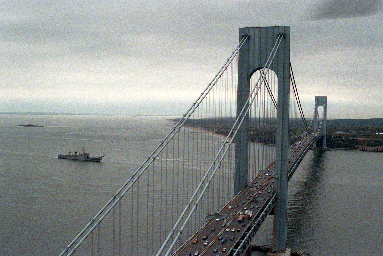 The tank landing ship USS FAIRFAX COUNTY (LST 1193) approaches the Verrazano Narrows Bridge as the vessel arrives for Navy Fleet Week activities