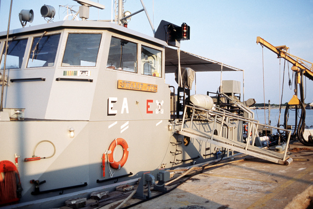 A close-up view of the torpedo weapon retriever TWR-821, informally named Swamp Fox, tied up to the pier. TWR-821 is among the units supporting Exercise LANTCOOPEX 1-89