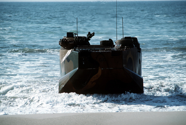 An AAVP-7 amphibious assault vehicle (AAV) carrying Marines of the 2nd Marine Division comes ashore on D-Day of the joint services exercise Solid Shield '89