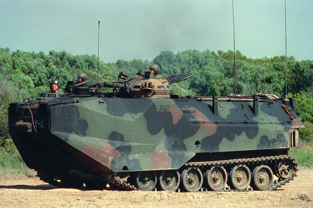 An AAVP-7 Amphibious Assault Vehicle (AAV) pauses on the beach before heading inland on D-Day of the joint services Exercise Solid Shield '89