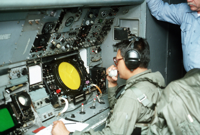 Aviation Anti-submarine Warfare Operator 1ST Class Rick Alcober communicates radar readings at sensor Station 3 aboard a P-3B Orion aircraft of Naval Air Reserve Patrol Squadron 68 (VP-68). VP-68 is in Rota for active duty training