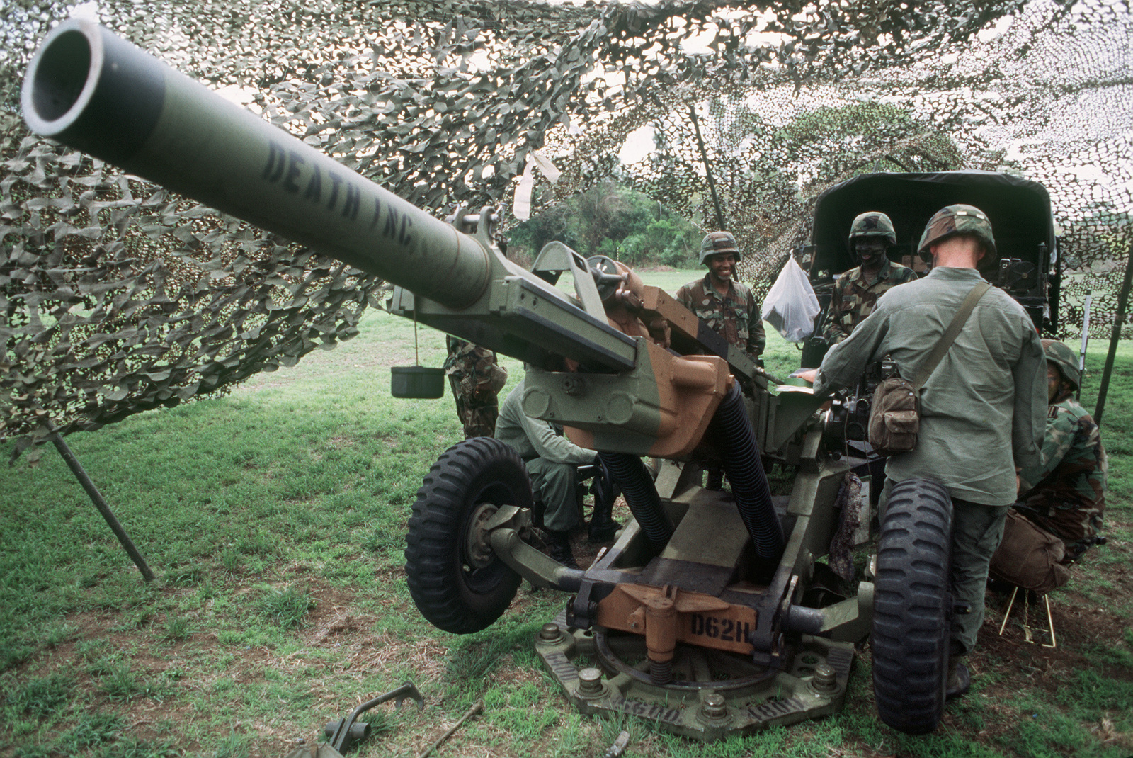 Members of the 4th Howitzer Section, D Battery, 320th Field