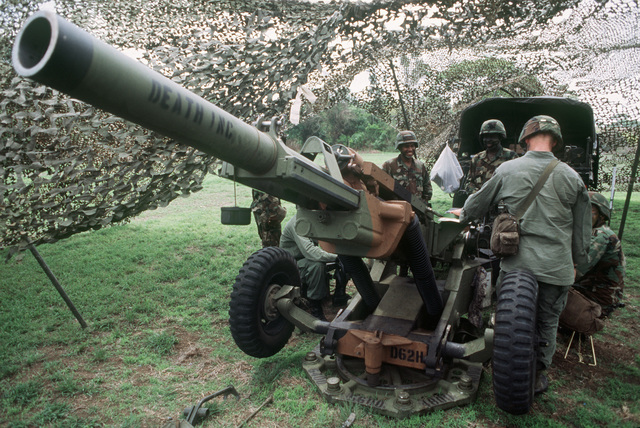 Members of the 4th Howitzer Section, D Battery, 320th Field Artillery, prepare their M102 105 mm howitzer for a live fire mission at Empire Range