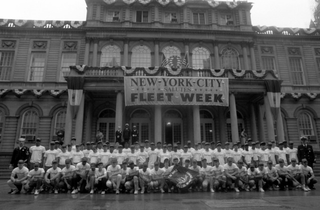 Members of the Big Apple Special Recruit Company gather for a photograph in front of city hall following their enlistment ceremony. The ceremony is being held in conjunction with the city's Fleet Week