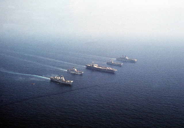 Ships from four nations sail in formation during the NATO Southern Region exercise DRAGON HAMMER '90. The ships are, from left: the British light aircraft carrier HMS INVINCIBLE (R-05), the Italian light aircraft carrier ITS GIUSEPPE GARIBALDI (C-551), the nuclear-powered aircraft carrier USS DWIGHT D. EISENHOWER (CVN 69), the Spanish aircraft carrier SPS PRINCIPE DE ASTURIAS (R-11) and the amphibious assault ship USS SAIPAN (LHA 2)