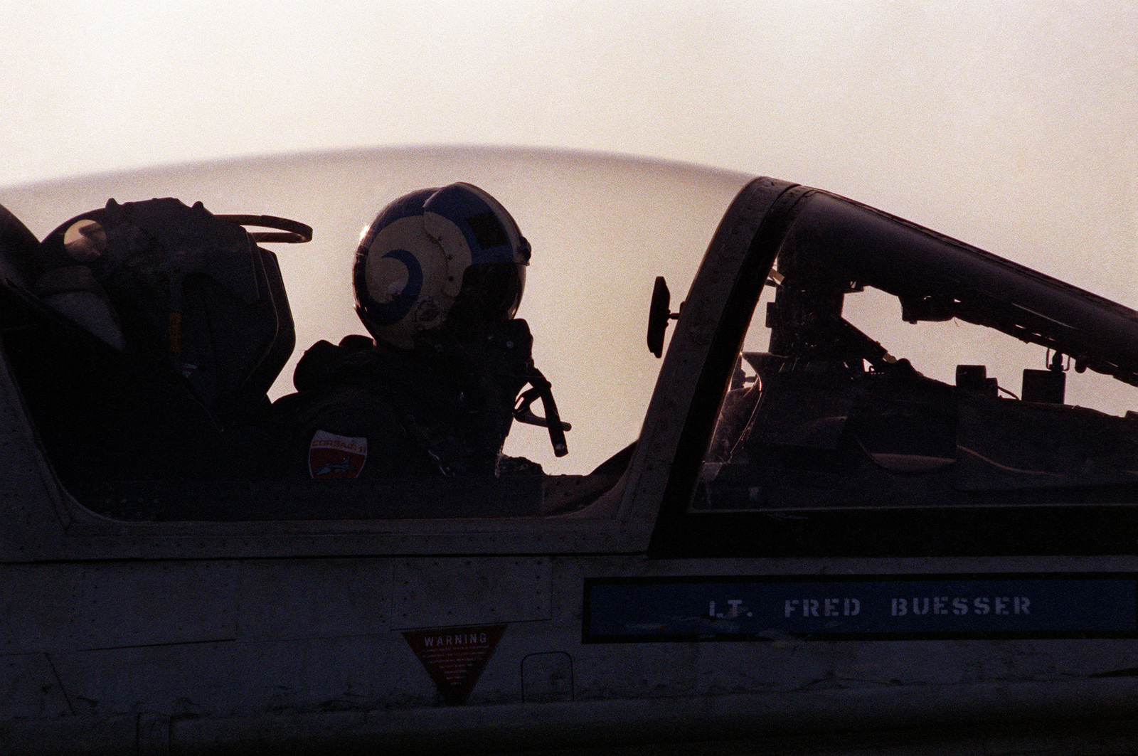 A pilot sits in the cockpit of an A-7 Corsair II aircraft after landing his plane aboard the aircraft carrier USS INDEPENDENCE (CV 62) during flight operations off the Virginia Capes