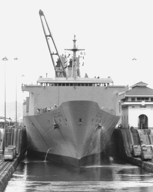 A bow view of the USNS BELLATRIX (T-AKR-88), a vehicle cargo ship, passing through a lock