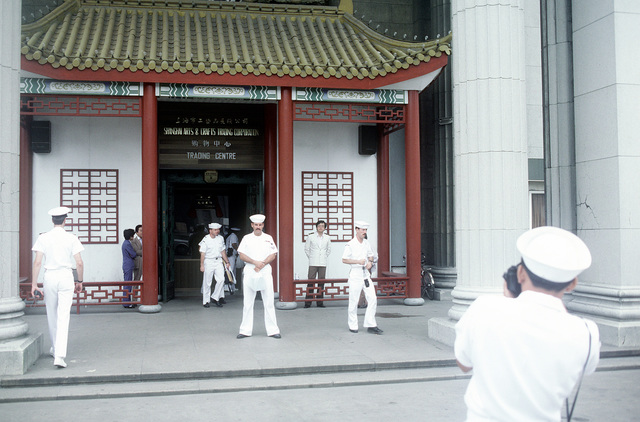 A U.S. sailor photographs his companions during a sightseeing expedition, part of a four-day U.S. naval goodwill visit to Shanghai
