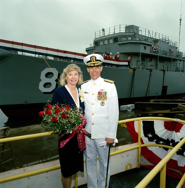 Mrs. Linda L. Hogan, ship's sponsor, poses for a picture with Rear Admiral (lower half) Stephen S. Clarey, Comptroller, Naval Sea Systems Command, following the christening ceremony for the countermeasures ship SCOUT (MCM 8)