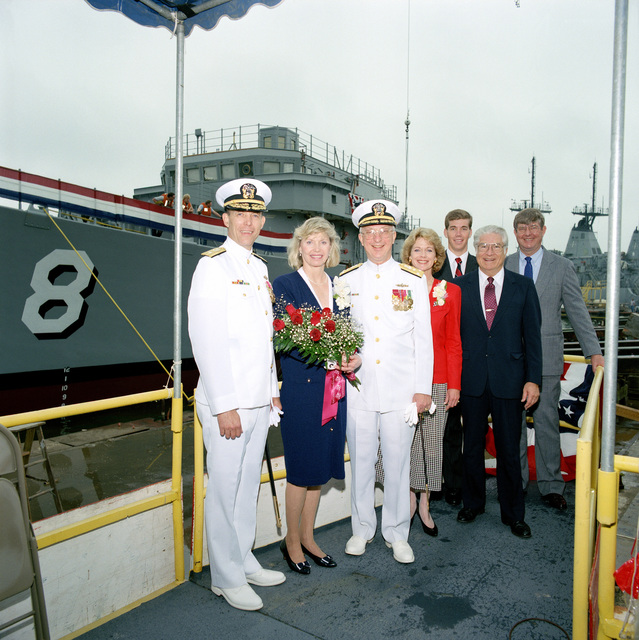Standing on the christening platform following the christening and launching ceremony for the mine countermeasures ship SCOUT (MCM 8) are, from left: Rear Admiral (lower half) Stephen S. Clarey, Comptroller, Naval Sea Systems Command: Mrs. Linda L. Hogan, ship's sponsor: Vice Admiral John W. Nyquist, Assistant CHIEF of Naval Operations, surface warfare: Penny Rhodes, Matron of Honor: Steven Hogan: Ellsworth L. Peterson, President, Peterson Builders, Inc., and Rear Admiral Edward J. Hogan USN (ret.)