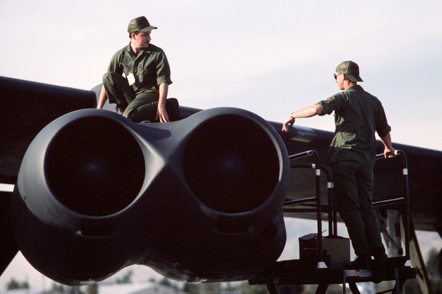 """STAFF Sergeant (SSGT) Michael Johnson, right, and a coworker from the 320th Bomb Wing check the engines of a B-52 Stratofortress aircraft following its arrival to participate in the 15th Air Force's first""""Shootout""""conventional bombing competition"""
