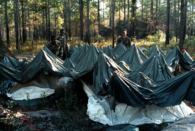 Marines set up a command post tent for use as a combat operations center (COC) during the joint services exercise Solid Shield '89