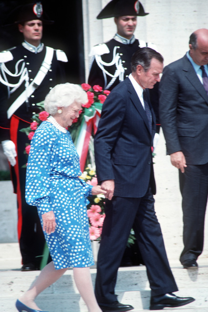 An honor guard stands by as President George H.W. Bush and Barbara Bush depart following speeches in honor of US military personnel killed during the World War II fight for southern Italy in 1943-44. The ceremony in memory of the veterans is being conducted at Sicily-Rome America Cemetery