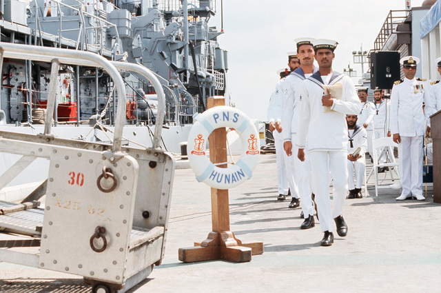 Pakistani Navy personnel prepare to board the guided missile frigate PNS HUNAIN during its commissioning ceremony.  The HUNAIN is a transfer from the US Navy, the ex-USS TALBOT (FFG 4)