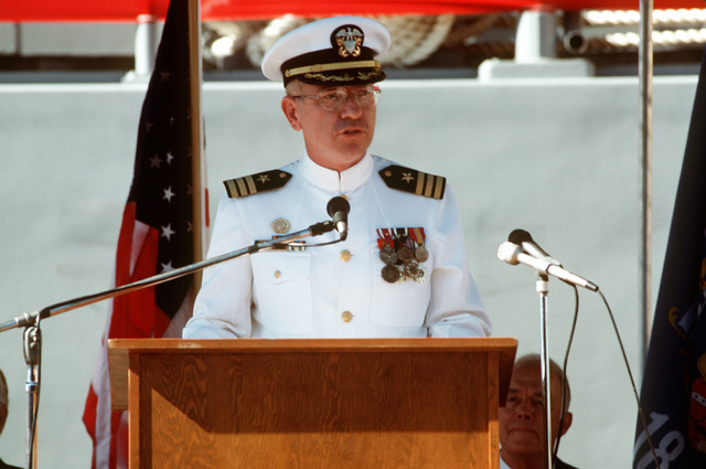 Commander Neil Collins, supervisor of shipbuilding, Sturgeon Bay, Wisconsin, speaks during the commissioning ceremony of the mine coutermeasure ship USS SENTRY (MCM 3)