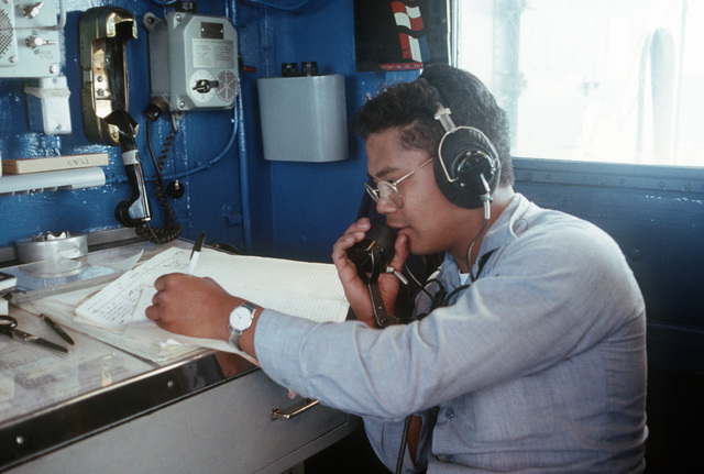 A Sailor takes notes as he receives a phone report aboard the Guided Missile Cruiser USS JOUETT (CG 29) off the Southern California coast