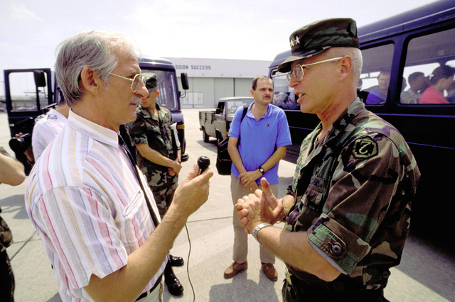MAJ. GEN. Richard T. Travis, European Command surgeon general, answers questions for an Associated Press correspondent regarding the arrival of members of the U.S. Army Burn Team from the Institute for Surgical Research. The team is at Rhein Main during a refueling stopover en route to the Soviet city of Ufa in Bashkiria to treat the victims of a gas line explosion which occurred near Ufa and enveloped two passenger trains bound for a Black Sea resort area