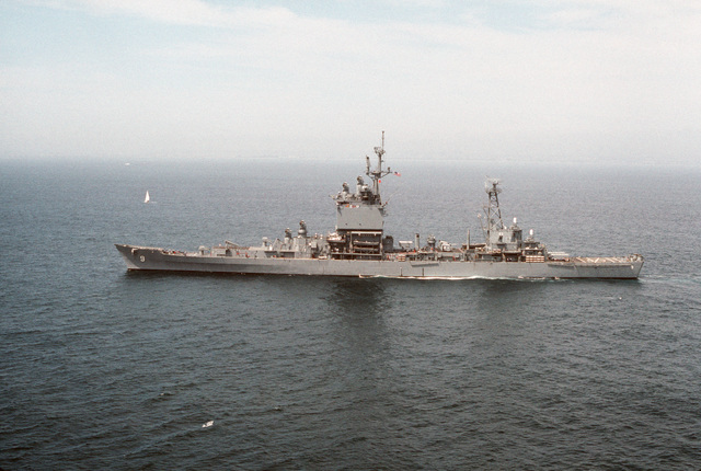 A port beam view of the nuclear-powered guided missile cruiser USS LONG BEACH (CGN 9) underway near the coast of Southern California
