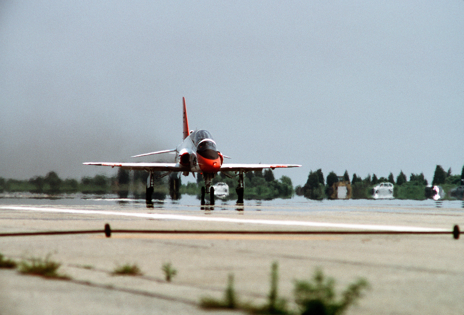 A T-45A Goshawk aircraft rolls down the runway after completing an evaluation flight. The Navy will eventually procure about 300 of these aircraft, which are capable of landing aboard aircraft carriers, to replace the T-2C Buckeye and TA-4J Skyhawk aircraft in the intermediate and advanced student pilot training role