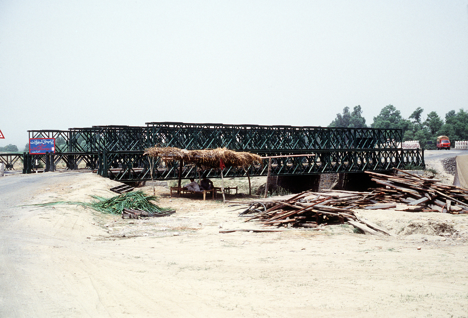 A view of a Bailey Bridge in use on the road between Peshawar and Islamabad. A similar bridge was sent from the U.S. to Pakistan for use by an Afghan guerrilla group that needs to span the Konar River outside of Jalalabad, Afghanistan