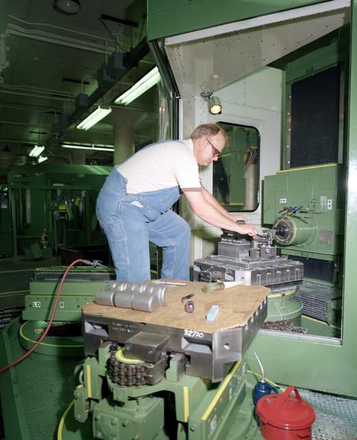 Don Mason works on a numerical control machine