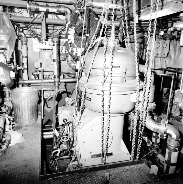 A view of the auxiliary engine room No. 2 aboard the guided missile cruiser COWPENS (CG 63). The ship is 70 percent complete