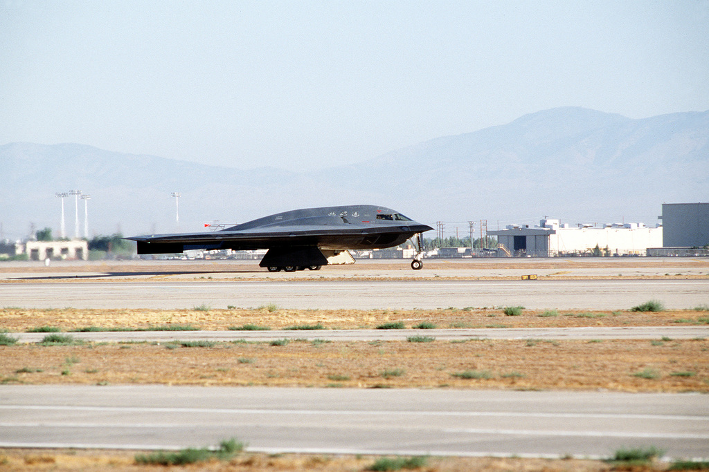 A right side view of a B-2 advanced technology bomber aircraft on the flight line at the Air Force Flight Test Center for its first test flight