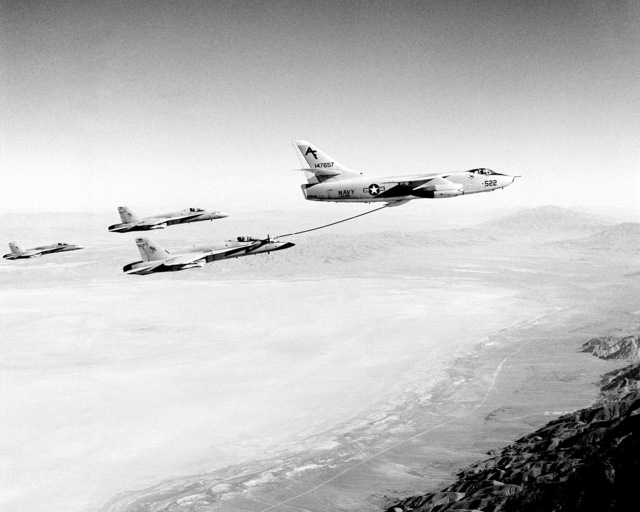 An Aerial Refueler Squadron 208 (VAK-208) KA-3B Skywarrior aircraft refuels a Strike Fighter Squadron 303 (VFA-303) F/A-18A Hornet aircraft as two other Hornets wait for their turn during refueling operations near Naval Air Station, Fallon, part of Reserve Carrier Air Wing 30 annual training operations