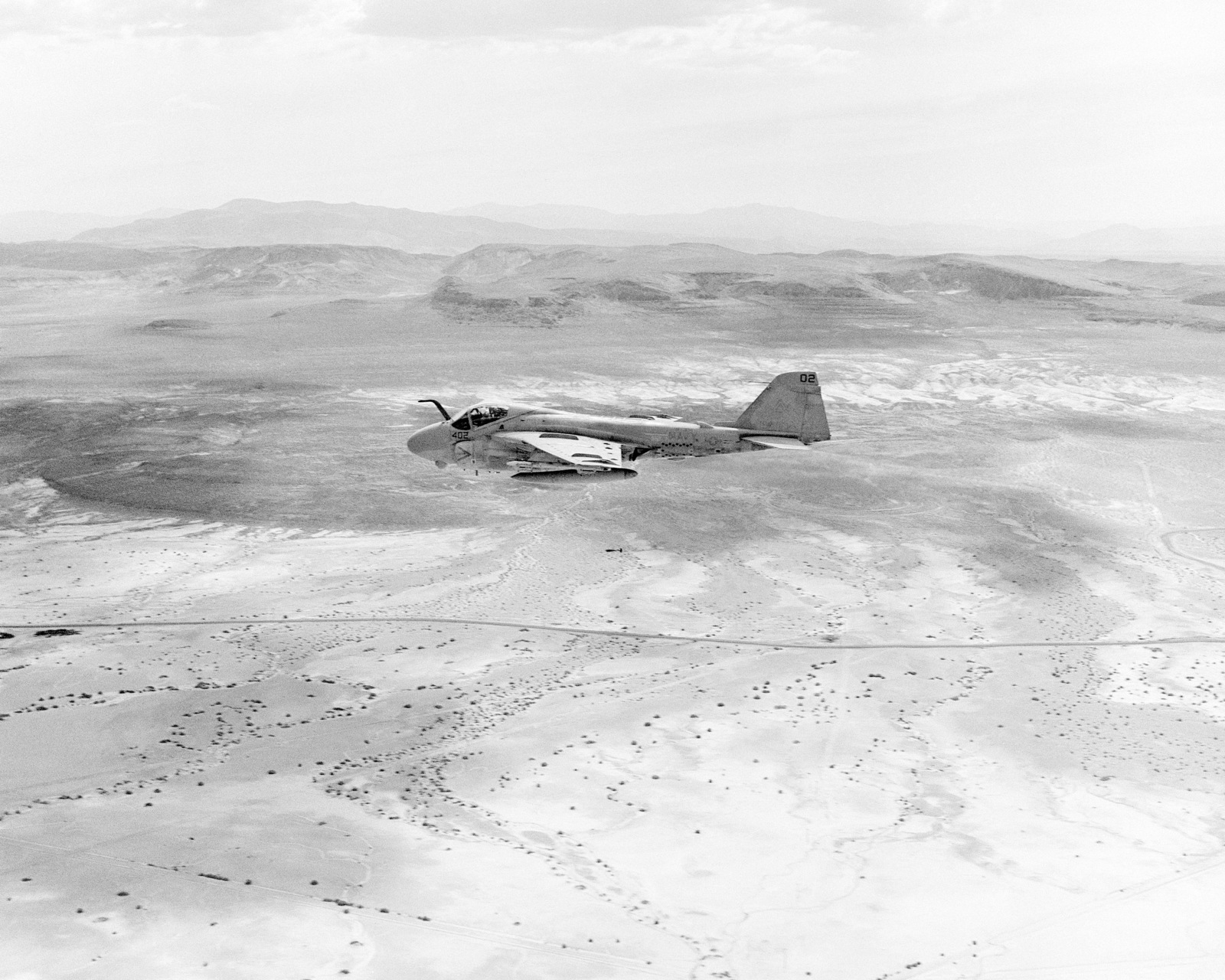 An air-to-air left side view of an Attack Squadron 304 (VA-304) A-6E Intruder aircraft near Naval Air Station, Fallon, during Reserve Carrier Air Wing 30 annual training operations