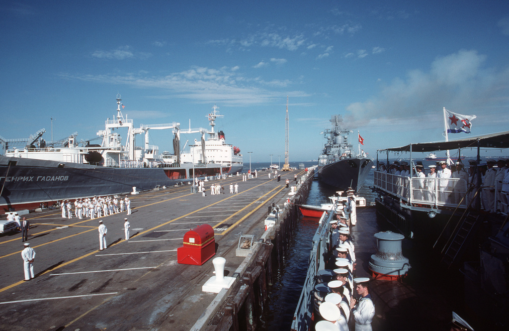Soviet Sailors man the rails aboard the Slava Class Guided Missile Cruiser MARSHAL USTINOV (CG 088), right foreground, the Sovremenny-Class Guided Missile Destroyer OTLICHNYY (DDG 434), right background, and the Boris Chilikinc Class Replenishment Oiler GENRIKH GASANOV, left, as the ships are tied up to the pier at the start of their five-day goodwill visit.  This is the first time that ships of the Soviet navy have visited an American military port