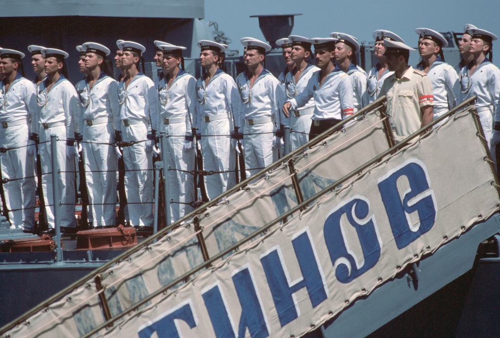 Soviet Sailors stand in formation near the brow of the Slava Class Guided Missile Cruiser MARSHAL USTINOV (CG 088).  MARSHAL USTINOV, the Guided Missile Destroyer OTLICHNYY (DDG 434) and the Oiler GENRIKH GASANOV are making the first-ever Soviet naval visit to a US military port