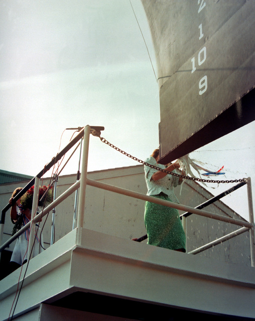 Julie Nixon Eisenhower, ship's sponsor, christens the guided missile cruiser GETTYSBURG (CG-64) during a ceremony at Bath Iron Workks shipyard
