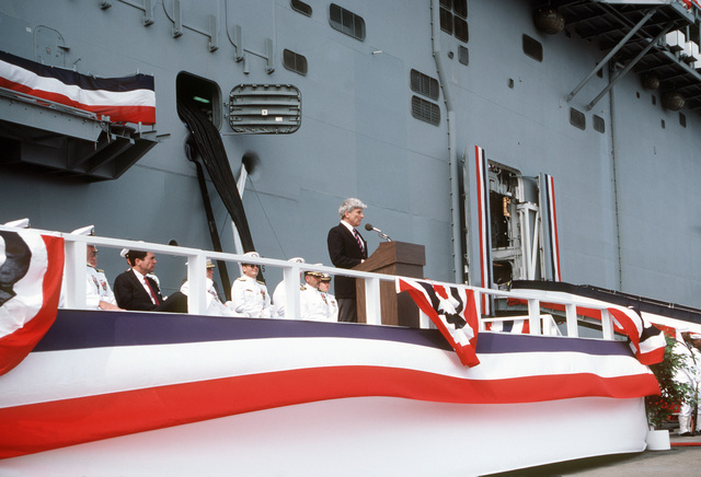 Senator John W. Warner, (R-VA), delivers a speech to the crowd gathered for the commissioning of the Amphibious Assault Ship USS WASP (LHD 1)