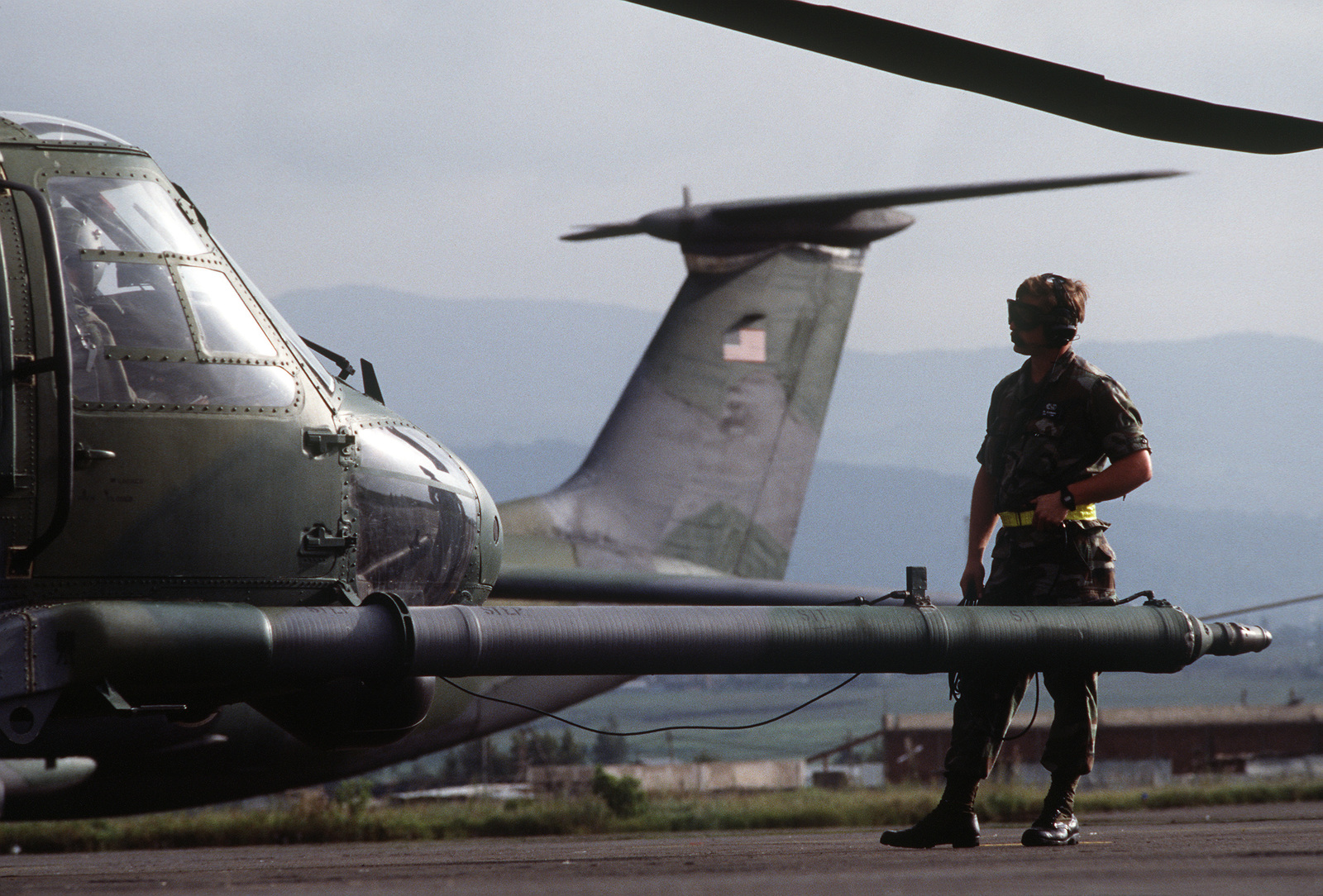 A ground crew member stands by a 55th Special Operations