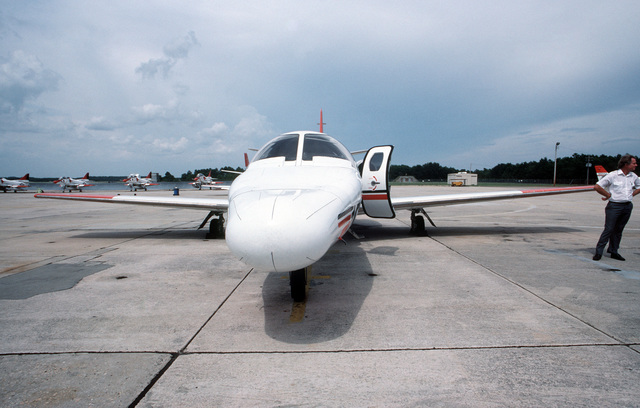 A T-47A Citation aircraft, used for training naval flight officers, is parked on the flight line