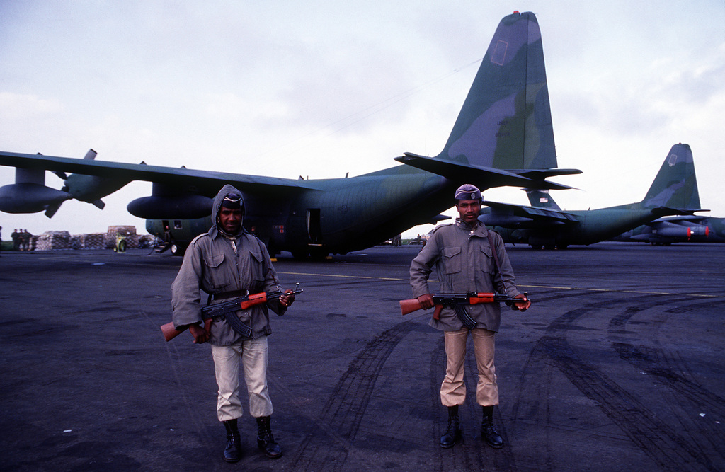 Ethiopian security guards equipped with 7.62mm AKM assault rifles stand near C-130 Hercules aircraft being used in a search and rescue mission for Texas Rep. George T. (Mickey) Leland and members of his delegation. The plane transporting Leland and 15 other people was reported missing en route to a refugee camp near the Sudanese border